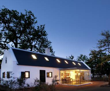 FARM_HOTEL_-_TWO_BEDROOM_COTTAGE_WITH_GLASS_KITCHEN_AT_NIGHT